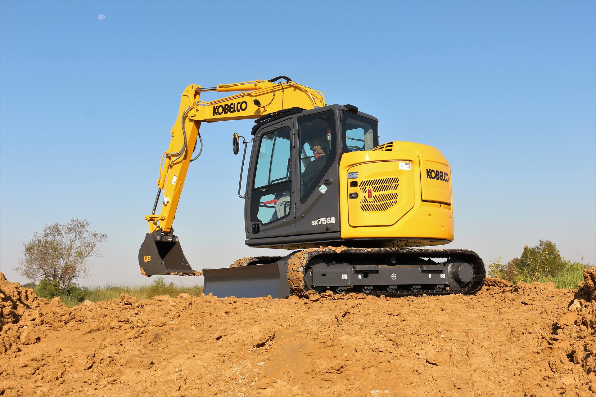 Kobelco SK75R-7 compact excavator with bucket