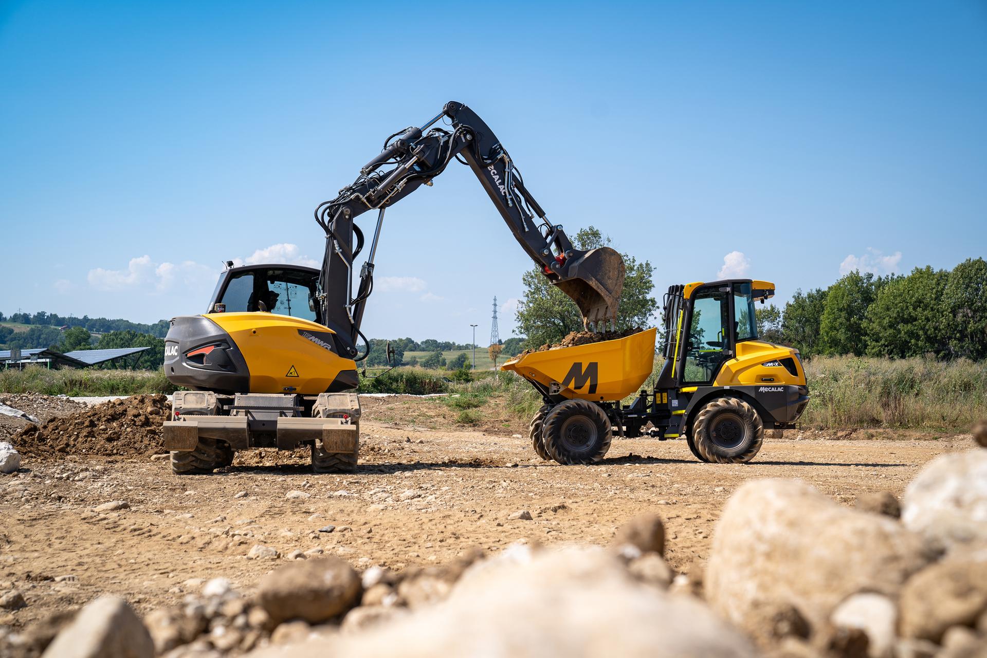 Mecalac 15MWR wheeled excavator loading